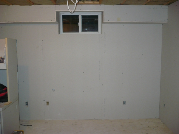 The new shack with drywall up.